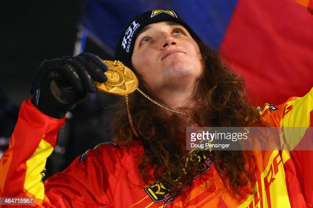 Colten Moore gestures skyward as he celebrates with the gold medal after winning the snowmobile freestyle finals at Winter XGames 2014 Aspen at...