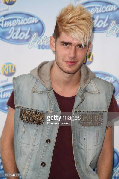 Colton Dixon attends American Idol presents first gold record to Phillip Phillips at Nokia Theatre LA Live on July 23 2012 in Los Angeles California