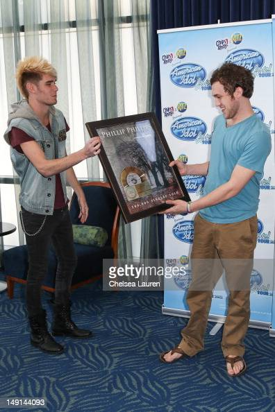 Colton Dixon presents a gold record to Phillip Phillips at American Idol presents first gold record to Phillip Phillips at Nokia Theatre LA Live on...