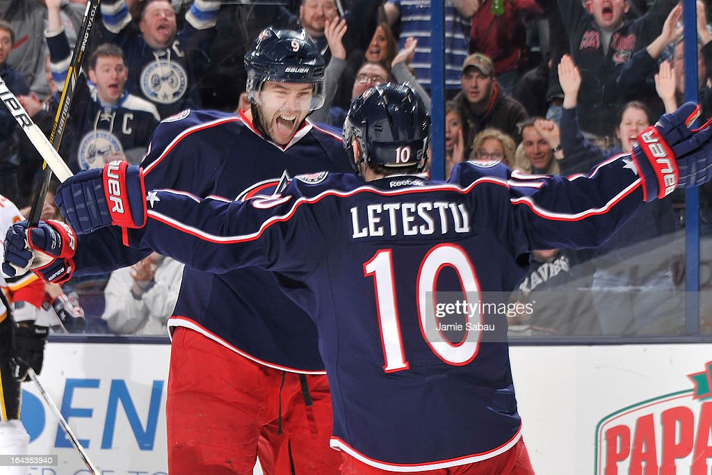 Colton Gillies #9 of the Columbus Blue Jackets celebrates with teammate Mark Letestu #10 of the Columbus Blue Jackets after scoring a goal in the third period against the Calgary Flames on March 22, 2013 at Nationwide Arena in Columbus, Ohio. Columbus defeated Calgary 5-1.