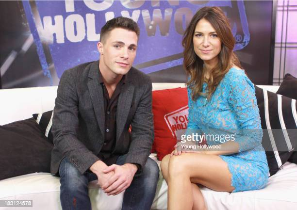 Colton Haynes and host Nikki Novak at the Young Hollywood Studio on October 4 2013 in Los Angeles California