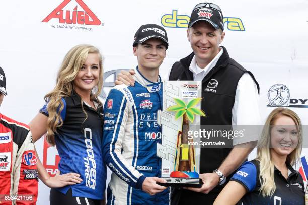 Colton Herta driver of the Deltro Energy AndrettiSteinbrenner Racing Mazda poses with the trophy following Race 2 of the Indy Lights Series Mazda...