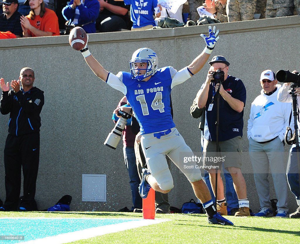 Colton Huntsman #14 of the Air Force Falcons celebrates after scoring a touchdown against the Notre Dame Fighting Irish at Falcon Stadium on October 26, 2013 in Colorado Springs, Colorado.
