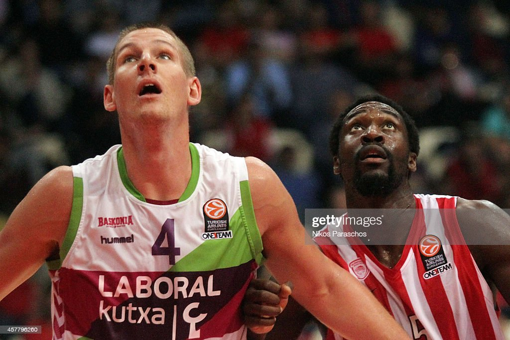 <a gi-track='captionPersonalityLinkClicked' href=/galleries/search?phrase=Colton+Iverson&family=editorial&specificpeople=5663882 ng-click='$event.stopPropagation()'>Colton Iverson</a>, #4 of Laboral Kutxa Vitoria competes with <a gi-track='captionPersonalityLinkClicked' href=/galleries/search?phrase=Othello+Hunter&family=editorial&specificpeople=4100810 ng-click='$event.stopPropagation()'>Othello Hunter</a>, #5 of Olympiacos Piraeus during the 2014-2015 Turkish Airlines Euroleague Basketball Regular Season Date 2 between Olympiacos Piraeus v Laboral Kutxa Vitoria at Peace and Friendship Stadium on October 24, 2014 in Athens, Greece.