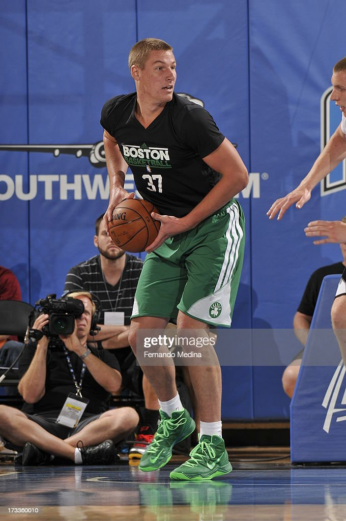 <a gi-track='captionPersonalityLinkClicked' href=/galleries/search?phrase=Colton+Iverson&family=editorial&specificpeople=5663882 ng-click='$event.stopPropagation()'>Colton Iverson</a> #37 of th eBoston Celtics looks to pass the ball against the Orlando Magic during the 2013 Southwest Airlines Orlando Pro Summer League on July 12, 2013 at Amway Center in Orlando, Florida.