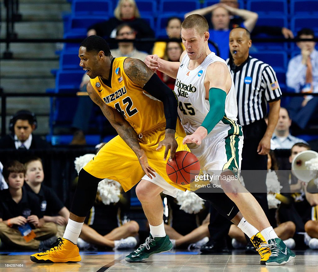 Colton Iverson #45 of the Colorado State Rams strips the ball against Alex Oriakhi #42 of the Missouri Tigers during the second round of the 2013 NCAA Men's Basketball Tournament at the Rupp Arena on March 21, 2013 in Lexington, Kentucky.
