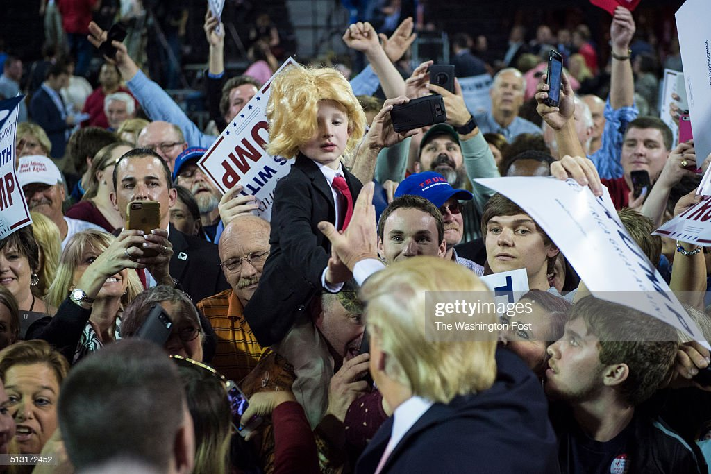 Colton Jordan, 5, dressed as Donald Trump reaches out to republican presidential candidate Donald Trump as he greets the crowd after speaking at a campaign event at the Valdosta State University in Valdosta, GA on Monday Feb. 29, 2016.