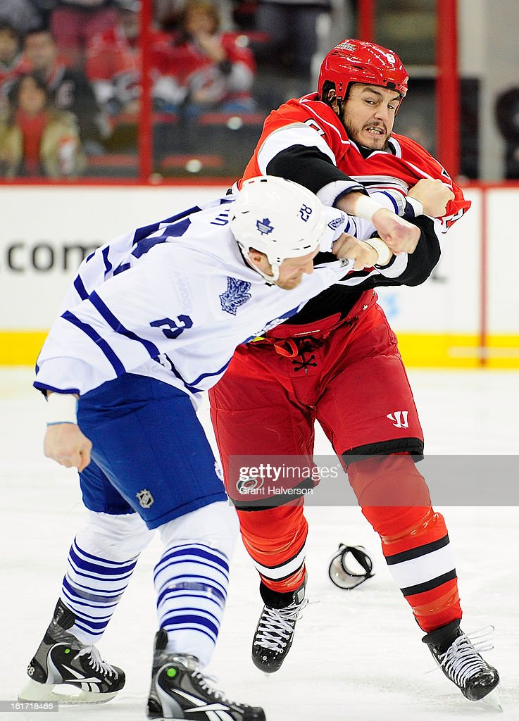 <a gi-track='captionPersonalityLinkClicked' href=/galleries/search?phrase=Colton+Orr&family=editorial&specificpeople=581689 ng-click='$event.stopPropagation()'>Colton Orr</a> #28 of the Toronto Maple fights with Kevin Westgarth #8 of the Carolina Hurricanes during the first period at PNC Arena on February 14, 2013 in Raleigh, North Carolina.