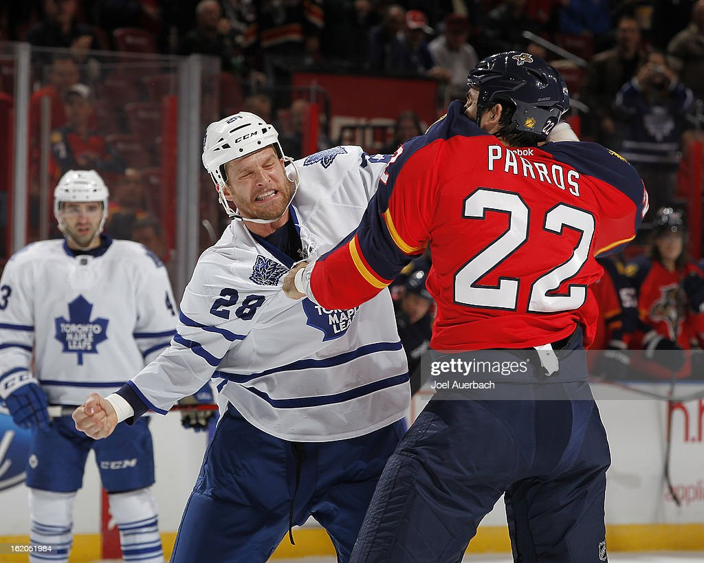 Colton Orr #28 of the Toronto Maple Leafs and George Parros #22 of the Florida Panthers fight during first period action at the BB&T Center on February 18, 2013 in Sunrise, Florida.