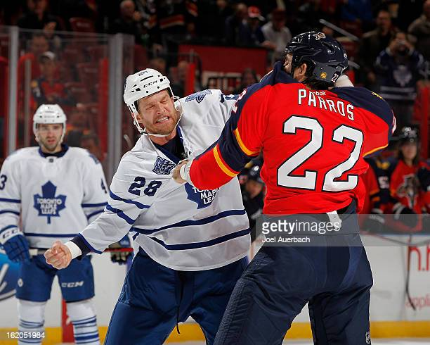 Colton Orr of the Toronto Maple Leafs and George Parros of the Florida Panthers fight during first period action at the BBT Center on February 18...