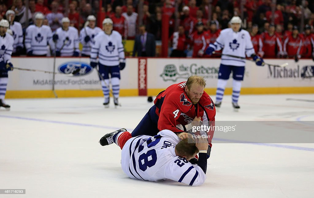 <a gi-track='captionPersonalityLinkClicked' href=/galleries/search?phrase=Colton+Orr&family=editorial&specificpeople=581689 ng-click='$event.stopPropagation()'>Colton Orr</a> #28 of the Toronto Maple Leafs and <a gi-track='captionPersonalityLinkClicked' href=/galleries/search?phrase=John+Erskine&family=editorial&specificpeople=215268 ng-click='$event.stopPropagation()'>John Erskine</a> #4 of the Washington Capitals fight during the second period at Verizon Center on January 10, 2014 in Washington, DC.