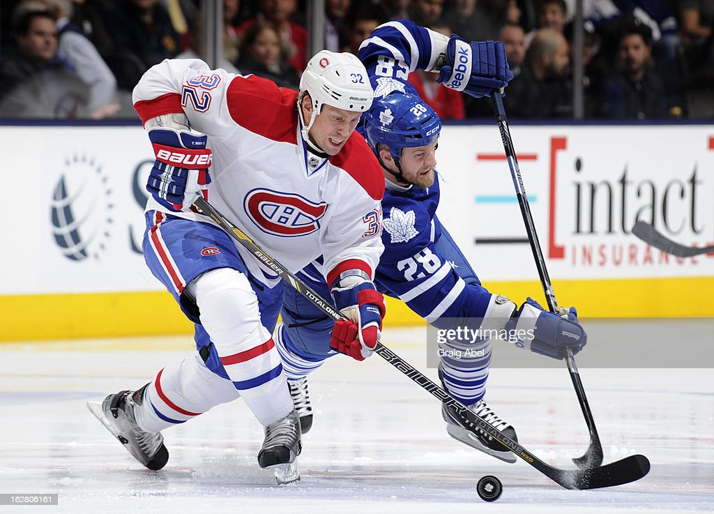 <a gi-track='captionPersonalityLinkClicked' href=/galleries/search?phrase=Colton+Orr&family=editorial&specificpeople=581689 ng-click='$event.stopPropagation()'>Colton Orr</a> #28 of the Toronto Maple Leafs battles for the puck with <a gi-track='captionPersonalityLinkClicked' href=/galleries/search?phrase=Travis+Moen&family=editorial&specificpeople=208110 ng-click='$event.stopPropagation()'>Travis Moen</a> #32 of the Montreal Canadiens during NHL game action February 27, 2013 at the Air Canada Centre in Toronto, Ontario, Canada.