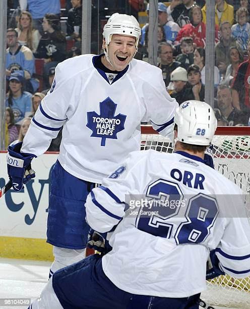 Colton Orr of the Toronto Maple Leafs celebrates his goal with Wayne Primeau against the Pittsburgh Penguins on March 28 2010 at Mellon Arena in...