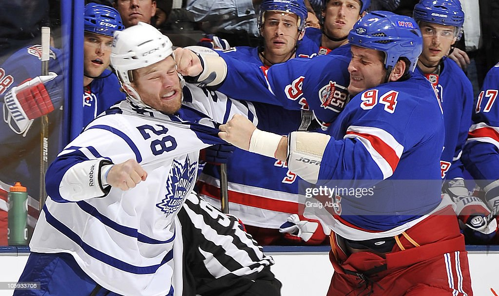 <a gi-track='captionPersonalityLinkClicked' href=/galleries/search?phrase=Colton+Orr&family=editorial&specificpeople=581689 ng-click='$event.stopPropagation()'>Colton Orr</a> #28 of the Toronto Maple Leafs fights with Derek Boogaard #94 of the New York Rangers during game action October 21, 2010 at the Air Canada Centre in Toronto, Ontario, Canada.