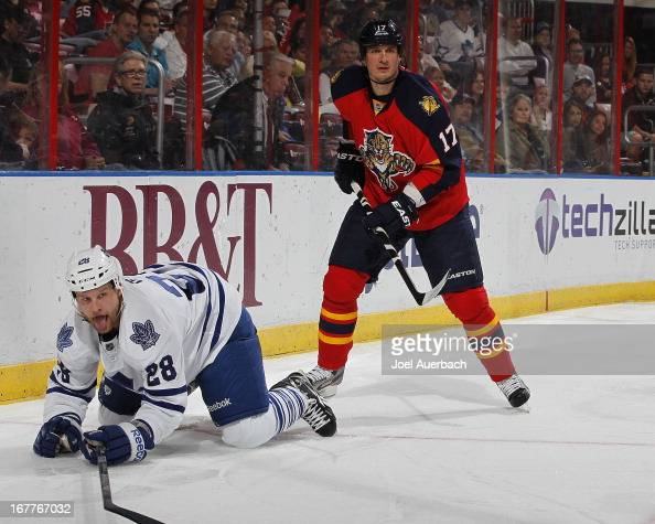 Colton Orr of the Toronto Maple Leafs is checked to the ice by Filip Kuba of the Florida Panthers at the BBT Center on April 25 2013 in Sunrise...