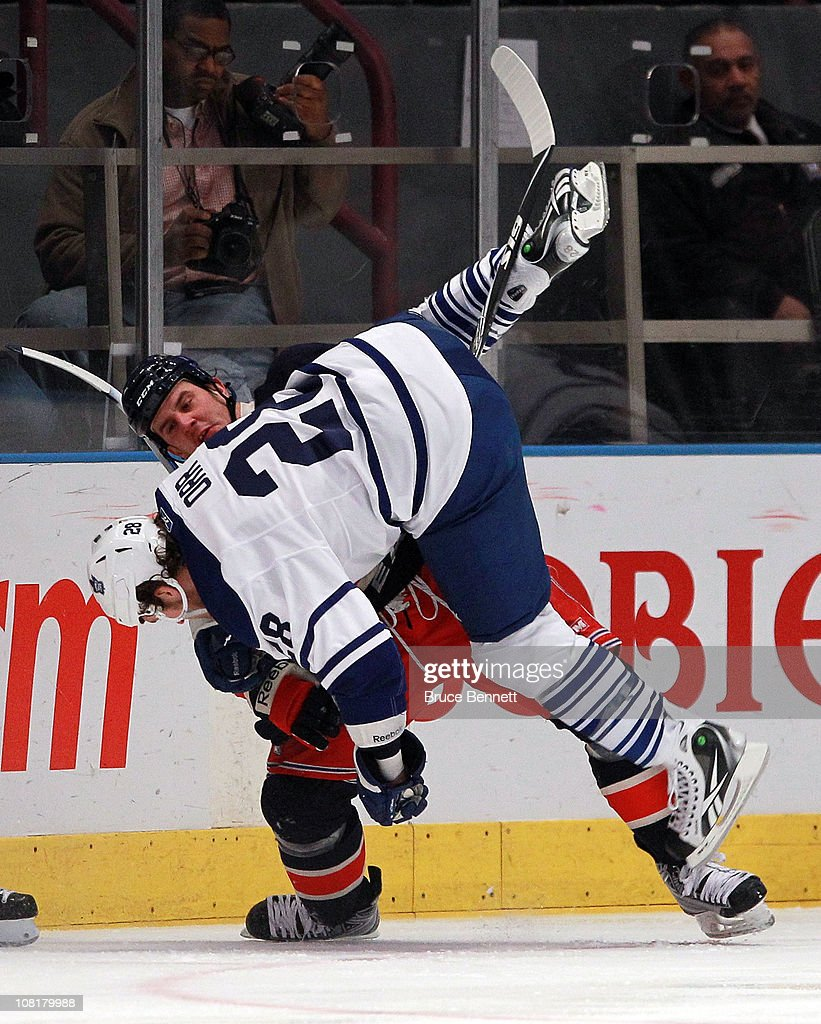 <a gi-track='captionPersonalityLinkClicked' href=/galleries/search?phrase=Colton+Orr&family=editorial&specificpeople=581689 ng-click='$event.stopPropagation()'>Colton Orr</a> #28 of the Toronto Maple Leafs is flipped over by Kris Newbury #45 of the New York Rangers during the first period at Madison Square Garden on January 19, 2011 in New York City.