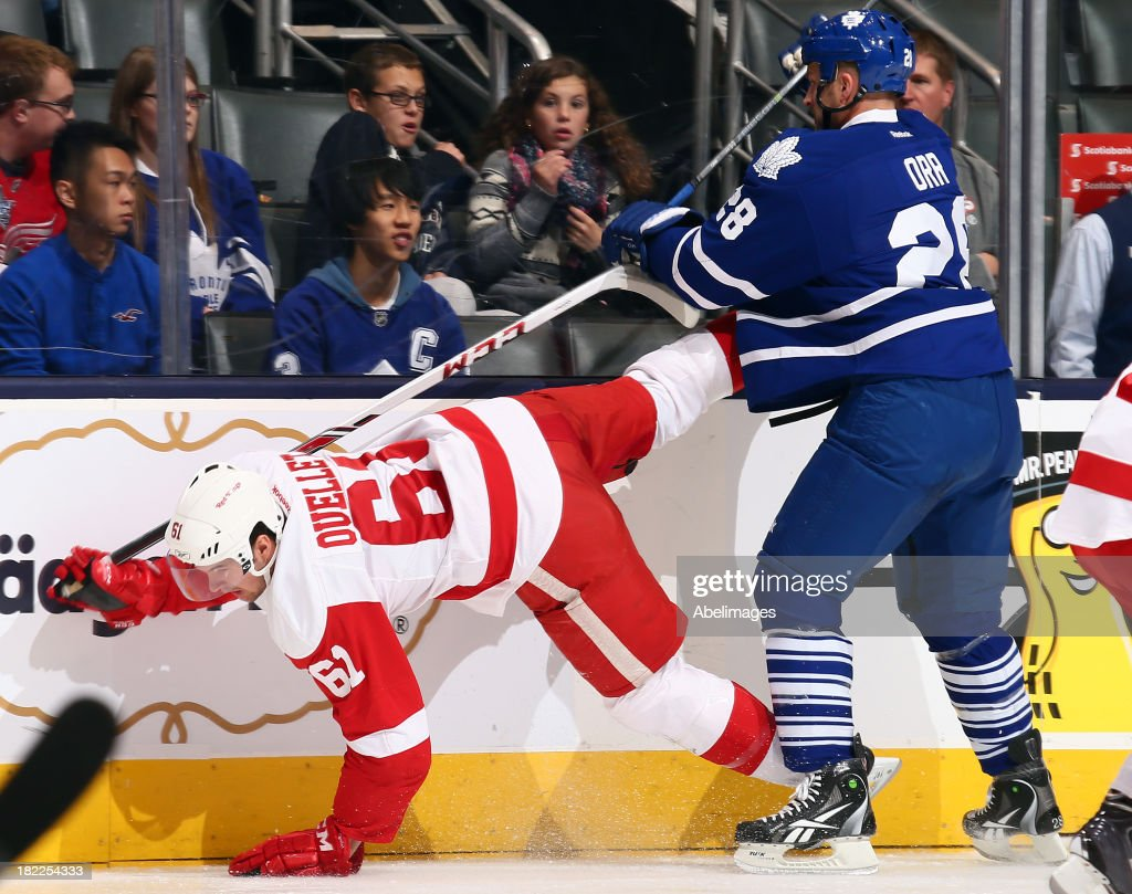 <a gi-track='captionPersonalityLinkClicked' href=/galleries/search?phrase=Colton+Orr&family=editorial&specificpeople=581689 ng-click='$event.stopPropagation()'>Colton Orr</a> #28 of the Toronto Maple Leafs runs into Xavier Ouellet #61 of the Detroit Red Wings during NHL Preseason action at the Air Canada Centre September 28, 2013 in Toronto, Ontario, Canada.