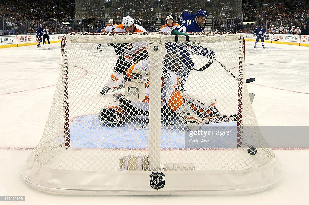 <a gi-track='captionPersonalityLinkClicked' href=/galleries/search?phrase=Colton+Orr&family=editorial&specificpeople=581689 ng-click='$event.stopPropagation()'>Colton Orr</a> #28 of the Toronto Maple Leafs scores a second period goal on <a gi-track='captionPersonalityLinkClicked' href=/galleries/search?phrase=Brian+Boucher&family=editorial&specificpeople=179370 ng-click='$event.stopPropagation()'>Brian Boucher</a> #33 of the Philadelphia Flyers during NHL game action February 11, 2013 at the Air Canada Centre in Toronto, Ontario, Canada.
