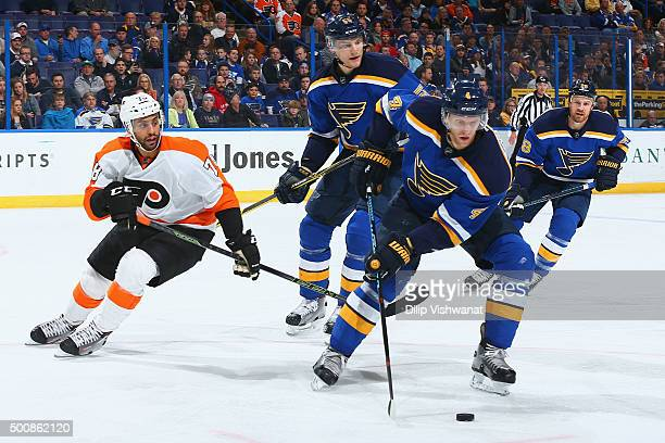 Colton Parayko and Carl Gunnarsson of the St Louis Blues beat PierreEdouard Bellemare of the Philadelphia Flyers to the puck at the Scottrade Center...