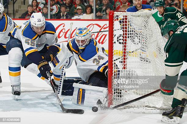 Colton Parayko and goalie Jake Allen of the St Louis Blues defend their goal against Zach Parise of the Minnesota Wild during the game on March 6...