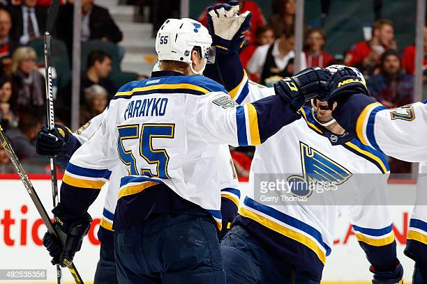 Colton Parayko and teammates of the St Louis Blues celebrate a goal against the Calgary Flames during an NHL game at Scotiabank Saddledome on October...