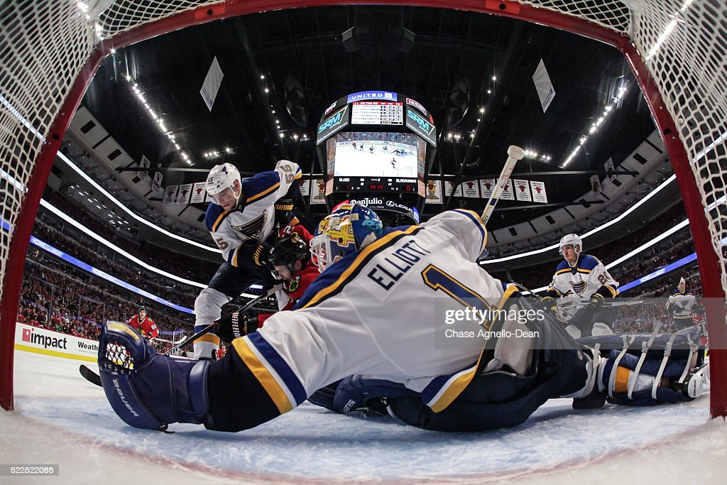 <a gi-track='captionPersonalityLinkClicked' href=/galleries/search?phrase=Colton+Parayko&family=editorial&specificpeople=8613096 ng-click='$event.stopPropagation()'>Colton Parayko</a> #55 of the St. Louis Blues and Marcus Kruger #22 of the Chicago Blackhawks chase the puck in front of goalie <a gi-track='captionPersonalityLinkClicked' href=/galleries/search?phrase=Brian+Elliott&family=editorial&specificpeople=687032 ng-click='$event.stopPropagation()'>Brian Elliott</a> #1 during Game Four of the Western Conference First Round during the 2016 NHL Stanley Cup Playoffs at the United Center on April 19, 2016 in Chicago, Illinois.