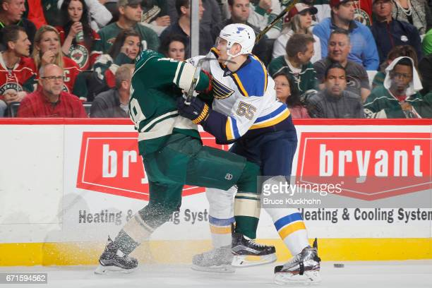 Colton Parayko of the St Louis Blues checks Martin Hanzal of the Minnesota Wild in Game Five of the Western Conference First Round during the 2017...