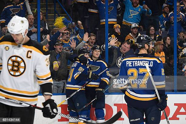 Colton Parayko of the St Louis Blues is congratulated by Patrik Berglund of the St Louis Blues after scoring a goal against the Boston Bruins on...