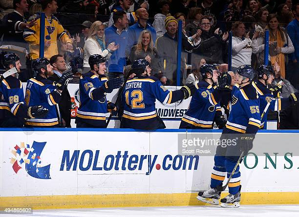 Colton Parayko of the St Louis Blues is congratulated by teammates after scoring the game winning goal against the Anaheim Ducks on October 29 2015...