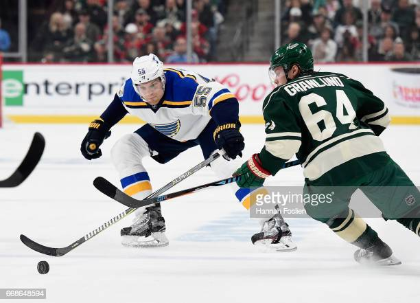 Colton Parayko of the St Louis Blues passes the puck past Mikael Granlund of the Minnesota Wild during the first period in Game Two of the Western...