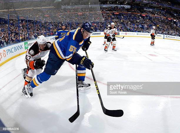 Colton Parayko of the St Louis Blues skates against Rickard Rakell of the Anaheim Ducks on October 29 2015 at Scottrade Center in St Louis Missouri