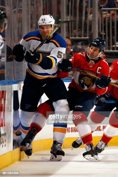 Colton Parayko of the St Louis Blues tangles with Derek MacKenzie of the Florida Panthers at the BBT Center on October 12 2017 in Sunrise Florida