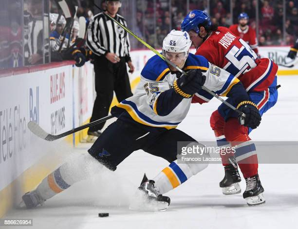 Colton Parayko of the St Louis Blues tries to keep the puck from Charles Hudon of the Montreal Canadiens in the NHL game at the Bell Centre on...