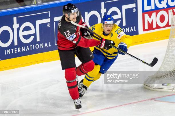 Colton Parayko vies with William Nylander during the Ice Hockey World Championship Gold medal game between Canada and Sweden at Lanxess Arena in...