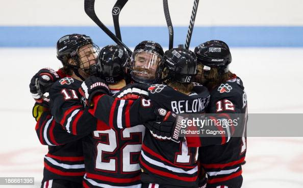 Colton Saucerman of the Northeastern University Huskies celebrates with teammates Jake Schechter Zach AstonReese Tanner Pond and Ryan Belonger during...