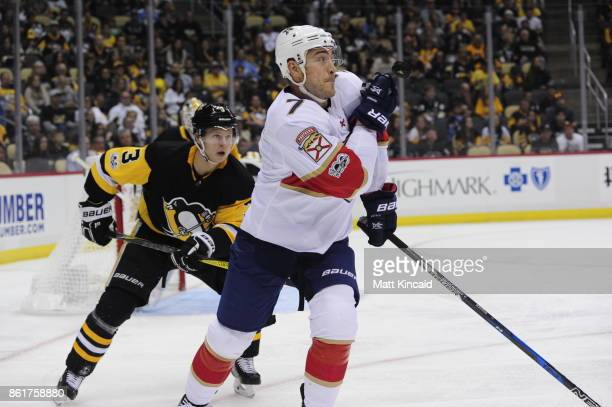 Colton Sceviou of the Florida Panthers watches the puck against Olli Maatta of the Pittsburgh Penguins at PPG PAINTS Arena on October 14 2017 in...