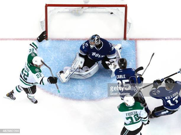 Colton Sceviour of the Dallas Stars celebrates the goal of teammate Vernon Fiddler against goalie Ben Bishop of the Tampa Bay Lightning during the...