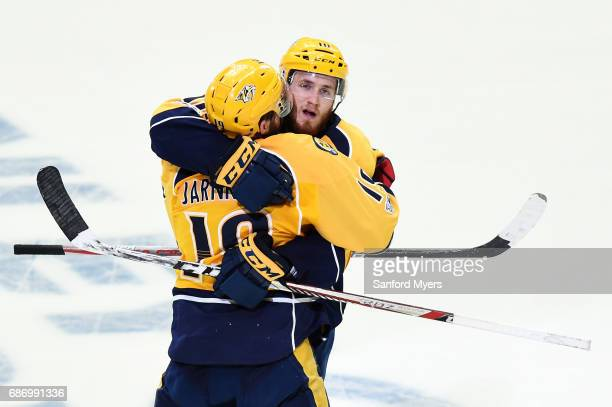 Colton Sissons celebrates a third period goal with Calle Jarnkrok of the Nashville Predators in Game Six of the Western Conference Final against the...