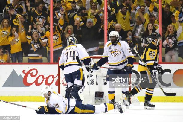 Colton Sissons goalie Juuse Saros and PK Subban of the Nashville Predators look on after allowing a fifth goal against the Pittsburgh Penguins in the...