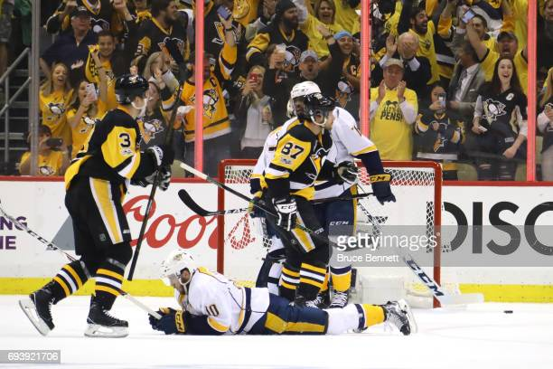 Colton Sissons goalie Juuse Saros and PK Subban of the Nashville Predators look on as Olli Maatta and Sidney Crosby of the Pittsburgh Penguins...