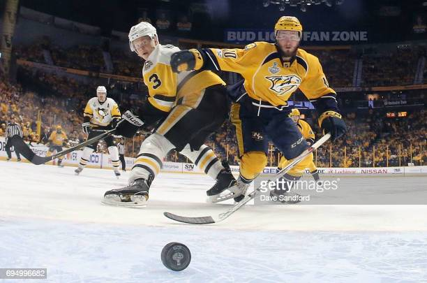 Colton Sissons of the Nashville Predators and Olli Maatta of the Pittsburgh Penguins look at the puck in the crease during the second period of Game...