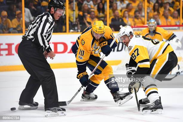 Colton Sissons of the Nashville Predators and Sidney Crosby of the Pittsburgh Penguins take a faceoff in the Predators zone in the first period of...