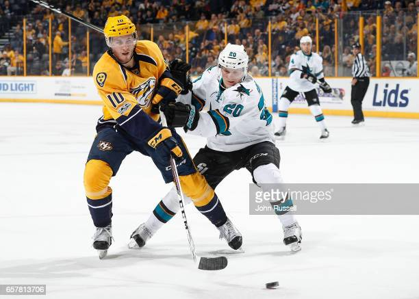 Colton Sissons of the Nashville Predators battles against Marcus Sorensen of the San Jose Sharks during an NHL game at Bridgestone Arena on March 25...