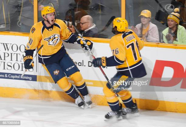 Colton Sissons of the Nashville Predators celebrates his goal with PK Subban against the Calgary Flames during an NHL game at Bridgestone Arena on...
