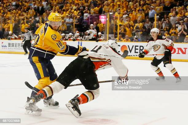 Colton Sissons of the Nashville Predators checks Cam Fowler of the Anaheim Ducks in Game Six of the Western Conference Final during the 2017 Stanley...