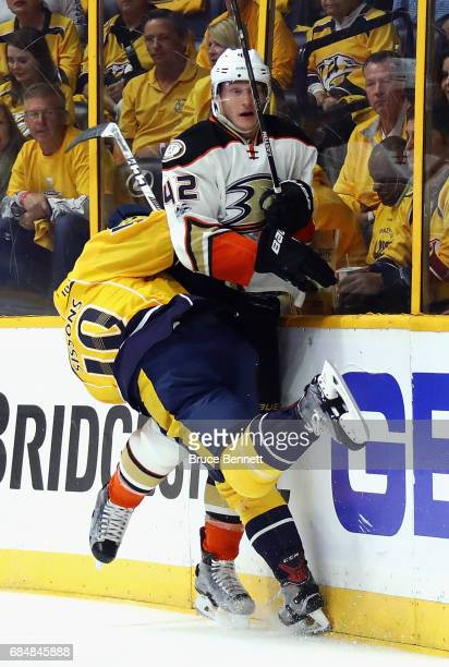 Colton Sissons of the Nashville Predators gets tangled up with Josh Manson of the Anaheim Ducks during the first period in Game Four of the Western...