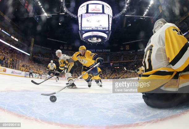 Colton Sissons of the Nashville Predators jumps to the puck to tap in the rebound after the whislte was blown while goaltender Tristan Jarry of the...