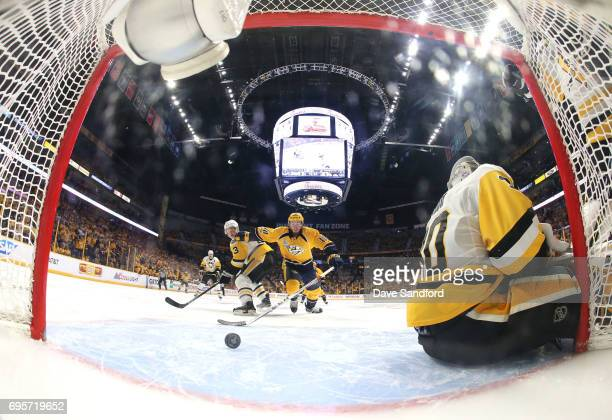 Colton Sissons of the Nashville Predators looks to play the puck after the whislte was blown while goaltender Matt Murray of the Pittsburgh Penguins...
