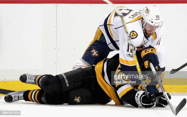 Colton Sissons of the Nashville Predators pins down Evgeni Malkin of the Pittsburgh Penguins to the ice during the second period of Game Five of the...