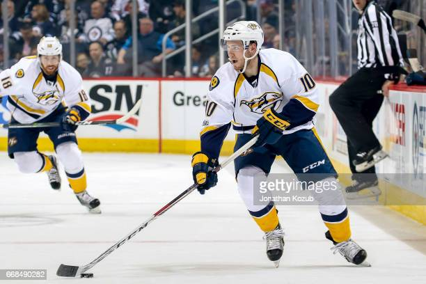 Colton Sissons of the Nashville Predators plays the puck down the ice during first period action against the Winnipeg Jets at the MTS Centre on April...